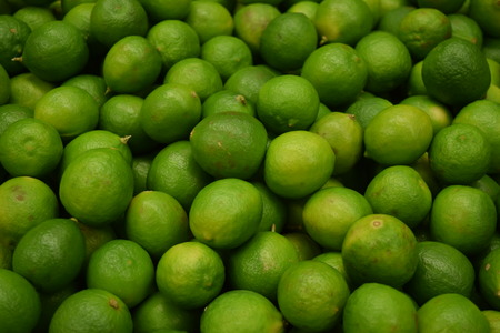 still lifes: Fresh limes isolated on green