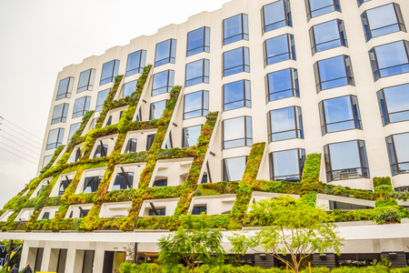 brings: West Sunset Boulevard,Los Angeles, California 01.16.2016: IAC Brings California native plants grace the scuptural facade of 8800 West Sunset Boulevard in West Hollywood Editorial