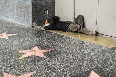 fame: Los Angeles, CA, USA . January 16, 2016: Hollywood Walk of Fame homeless man on the street, sidewalk