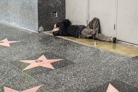 Los Angeles, CA, USA . January 16, 2016: Hollywood Walk of Fame homeless man on the street, sidewalk