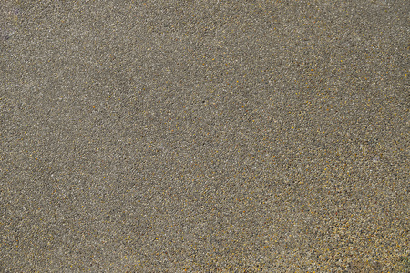 pebblestone: stone clad sidewalk, pebblestone sidewalk, Old Stone Country Road. Old Asphalt Road. Seamless Tileable Texture with Protruding Stones Stock Photo