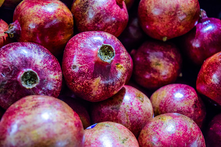 garnets: Healthy food, pomegranates background Garnets