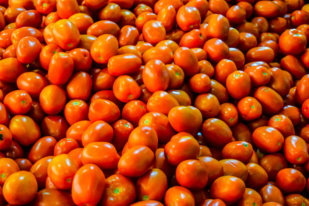 Red tomatoes at open air market Stock Photo