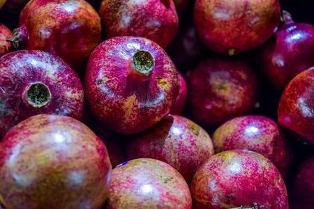 garnets: Healthy food, pomegranates background Garnets.