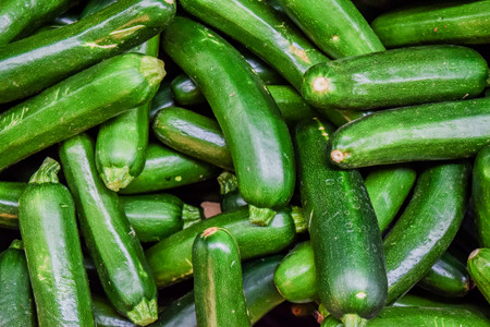 Fresh cropped green Zucchini; Offer in the vegetable market Stock Photo