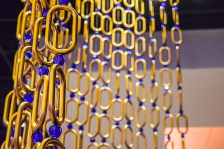 iron curtains: Long and wide chain curtains gold tone Stock Photo