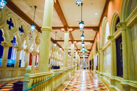 gondoliers: Las Vegas, NV, USA . January 21, 2016:  The Venetian Resort Hotel & Casino. The resort opened on May 3, 1999 with flutter of white doves, sounding trumpets, singing gondoliers