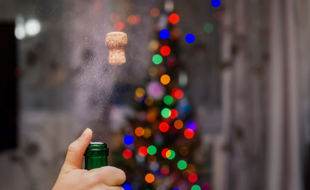 Shot Martini champagne cork out of the bottle when high-speed shooting. Spray and smoke.