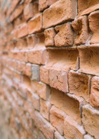 deadlock: Old brick wall in the city. there is a danger of collapse . It needs to be replaced .