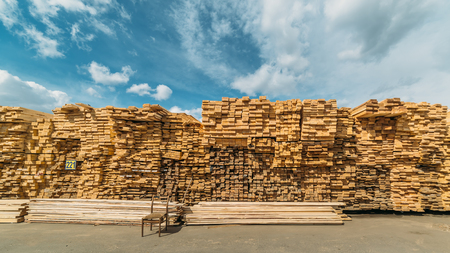 treated board: open-air market in the city of lumber . a lot of different construction materials from wood. Stock Photo