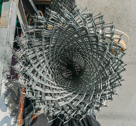 sickly: coil of barbed wire on the counter in the store . building materials store in the open air