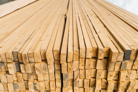 construction materials: open-air market in the city of lumber . a lot of different construction materials from wood. Stock Photo