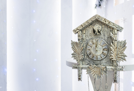 10 12 years: Old cuckoo clock in the new year show the remaining time before Christmas. Time 00.00 12.00