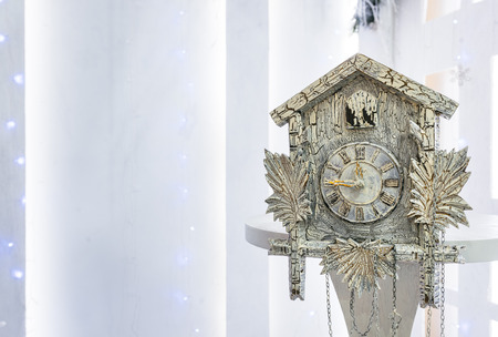 10 12 years: Old cuckoo clock in the new year show the remaining time before Christmas. Time 23.45 11.45
