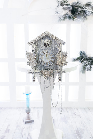 show time: Old cuckoo clock in the new year show the remaining time before Christmas. Time 00.00 12.00