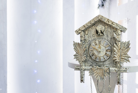 show time: Old cuckoo clock in the new year show the remaining time before Christmas. Time 23.50 11.50