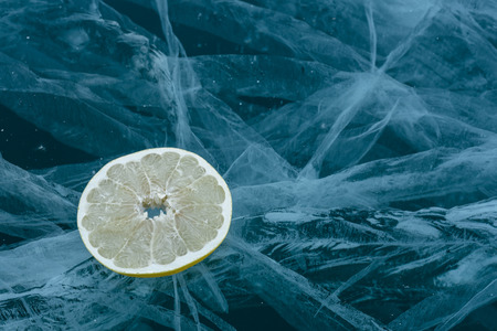 Pomelo fruit is beautiful on pure ice. One of the most beautiful glacial lakes on earth - Lake Baikal.