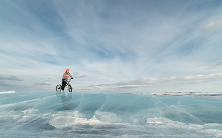 racing bike: Girl standing on a bmx on the beautiful and dangerous ice.