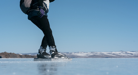 Norwegian hiking skates. Tourists travel to Norway hiking ice skating on the frozen lake. Special long skate for long distances. Mounting under the ski boots. Location of Lake Baikal action. An experimental tour skates for prolonged trips to the ice. Stock Photo