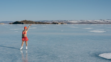 bather: Girl extreme sportswear in a swimsuit on the ice. Ice lady. A female beginner skater skates and poses on skates, and tans. She has a beautiful body, strong health and great courage. Its freezing outside. Stock Photo