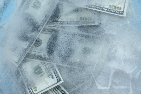 100 dollars frozen melt. Banknotes frozen in ice. Stok Fotoğraf