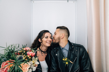 Wedding in the style of rock. Rocker or Biker wedding. Guys with stylish leather jackets. Its a rocknroll baby. The sweet couple are photographed in a photobooth. Reklamní fotografie