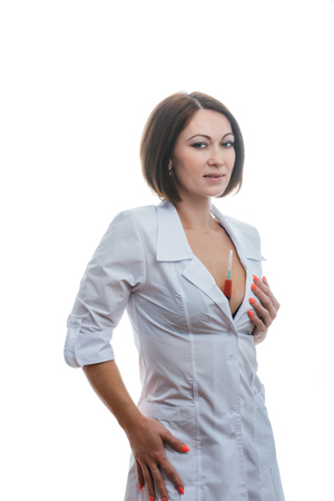 Sexually doctor woman on isolated white background. Caucasian woman medic with beautiful sexy pantyhose, bra and panties. The girl has a big syringe with a red liquid. Stockfoto