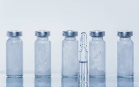 Glass medical ampoule vial for injection. Medicine is liquid sodium chloride with of aqueous solution in ampulla.