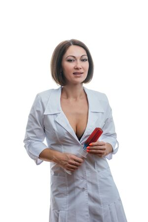 Sexually doctor woman on isolated white background. Caucasian woman medic with beautiful pantyhose, bra and panties. The girl has a big syringe with a red liquid.