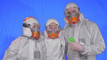 Family of doctors scientists health worker in respirator. Mom, dad and daughter portrait, wearing protect medical aerosol spray paint mask. Ball spike model Coronavirus pandemic covid-19.