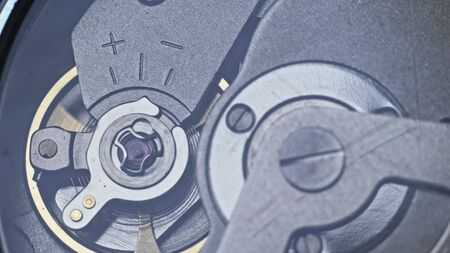 Watch mechanism macro loop. Old vintage clock mechanism working, closeup shot with soft focus. Close up of a internal clock mechanism. Watch gears movement macro. Time Keeping. 版權商用圖片
