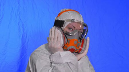 Scientist virologist in respirator. Slow motion. Woman close up look wearing protective medical mask. Concept health safety N1H1 virus protection coronavirus epidemic 2019 nCoV. Chroma key blue film.