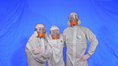 The family shield protect, to save life from virus. Slow motion. People portrait, wearing protect medical aerosol spray paint mask respirator. Concept health safety protection coronavirus epidemic. Archivio Fotografico