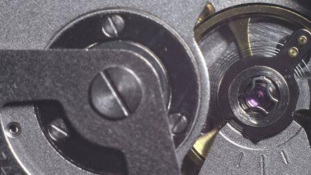 Watch mechanism macro loop. Old vintage clock mechanism working, closeup shot with soft focus. Close up of a internal clock mechanism. Watch gears movement macro. Time Keeping. Imagens