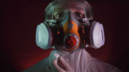 Man in protective costume suit, gas protect medical antibacterial antiviral spray paint mask. Doctor health worker in respirator.