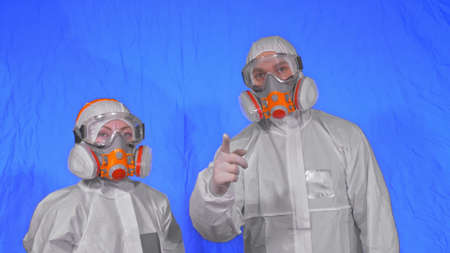 Doctor health worker in respirator. Slow motion. People portrait, wearing protect medical antibacterial antiviral aerosol spray paint mask.