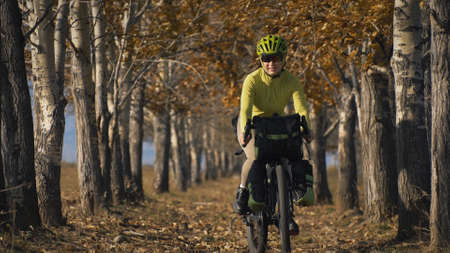 The woman travel on mixed terrain cycle touring with bike packing. The traveler journey with bicycle bags. Sport tourism bikepacking.