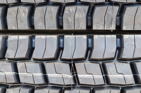traction: Textured pattern of a new truck tire background