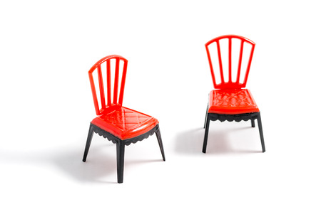 Red plastic chair on white background
