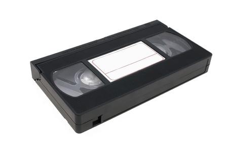 videokassette: Videocassette schwarz Verlegung auf einen wei�en Hintergrund mit einem Label f�r Beschriftungen. Lizenzfreie Bilder