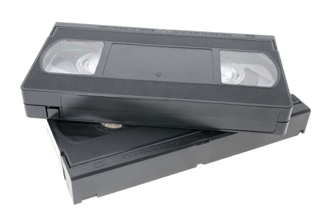 Two videocassettes of black color on a white background photo