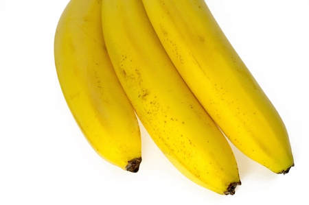 Three ripened yellow, tasty bananas on a white background. photo