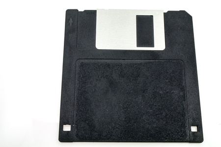 One black diskette isolated on white background photo