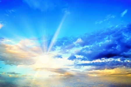 ascended: The sun has ascended over the sea and shines because of clouds  Stock Photo