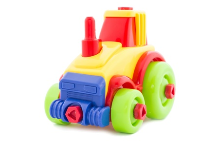 Toy a nursery plastic, a tractor wheel on a white background  photo