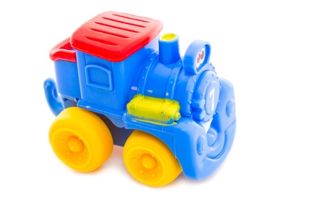 Toy a nursery plastic, a steam locomotive on a white background  Stock Photo - 15149324