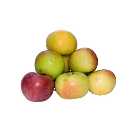 Apples combined by a pyramid on a white background  photo