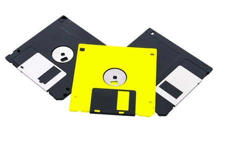 rewrite: Three diskettes, black and yellow, on a white background it is isolated. Stock Photo