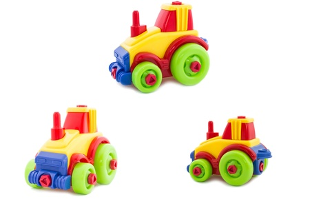 Set  Toy a nursery plastic, a tractor wheel on a white background  photo