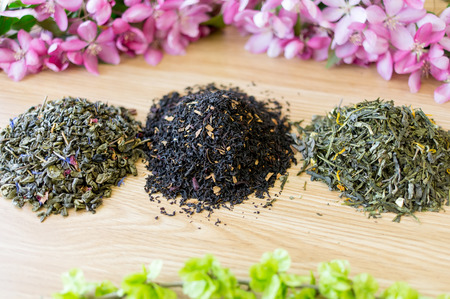 blends: Three various refined tea blends on a wooden table. Stock Photo